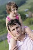 Man carrying girl Stock Photography