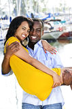 Man carrying girlfriend. Man carrying his girlfriend standing at harbor royalty free stock photos