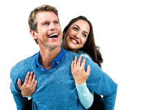Man carrying girlfriend on back Royalty Free Stock Photo