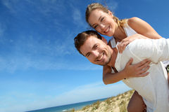 Man carrying girlfriend on his back Royalty Free Stock Photography