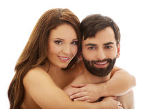 Man carrying girlfriend on his back. Royalty Free Stock Images