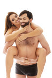Man carrying girlfriend on his back. Royalty Free Stock Photo