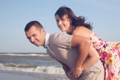 Man carrying girlfriend Stock Photo