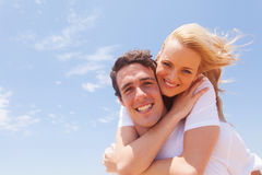 Man carrying girlfriend Stock Photography