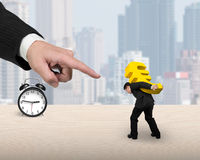 Man carrying golden euro sign with big forefinger pointing at Royalty Free Stock Images