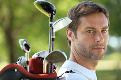 Man carrying golf bag Stock Photography