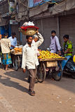 Man carrying goods on his head at Chawri Bazar in Delhi, India Royalty Free Stock Photos