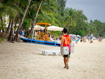 A man carrying goods on shoulder in Boracay, Philippines Stock Photography
