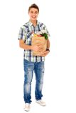 Man carrying grocery bag Royalty Free Stock Photography
