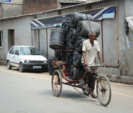A man carrying heavy goods on street in Amritsar, India Stock Photography