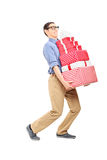 Man carrying a heavy load of presents Royalty Free Stock Photos