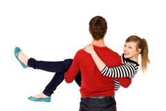 Man carrying his girlfriend in his arms Royalty Free Stock Photos