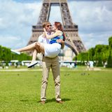 Man carrying his girlfriend in his arms Stock Photo