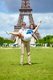 Man carrying his girlfriend in his arms Stock Photography
