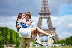 Man carrying his girlfriend in his arms Stock Images
