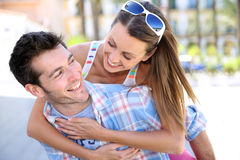 Man carrying his girlfriend on his back Stock Images