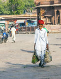 Man carrying his Shopping at the Sadar Market in Jodhpur, India Stock Photo