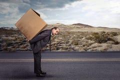 Man carrying large carton box Royalty Free Stock Images