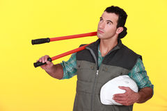 Man carrying large pliers Stock Photo