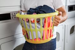 Man Carrying Laundry Basket Royalty Free Stock Image