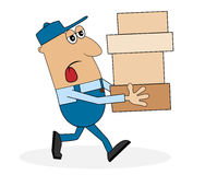 A man carrying a lot of boxes Stock Images