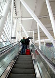Man Carrying luggage at the Toronto Pearson Airport Stock Images
