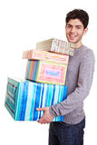 Man carrying many christmas gifts Royalty Free Stock Photos