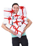 Man carrying many gift boxes Stock Image
