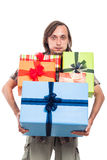Man carrying many gifts Royalty Free Stock Photos