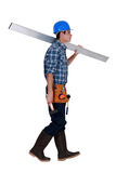 Man carrying metal beam Royalty Free Stock Photo