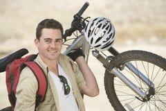 Man Carrying Mountain Bike Royalty Free Stock Photography