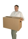 Man carrying moving box Stock Images