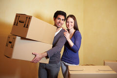 Man carrying moving boxes Royalty Free Stock Images