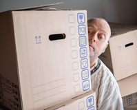 Man carrying moving boxes Stock Photos