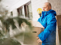 Man carrying moving boxes Stock Photo