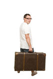 Man carrying an old suitcase Stock Photo
