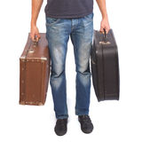 A man carrying old suitcases Stock Photos