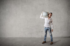 Man carrying an old television Stock Image