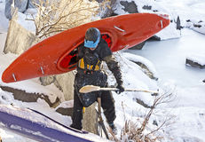 Man Carrying Orange Kayak In Snow Stock Images