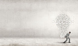 Man carrying out idea Royalty Free Stock Images