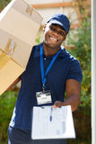 Man carrying parcel Stock Photos
