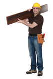 Man carrying parquet flooring Royalty Free Stock Photo