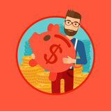 Man carrying piggy bank. Stock Images