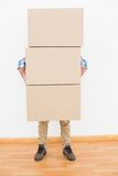 Man carrying pile of cardboard moving boxes Royalty Free Stock Images
