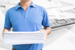 Man Carrying Pile Of Paperwork Royalty Free Stock Photography