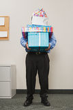 Man carrying pile of presents Royalty Free Stock Photo