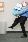 Man carrying pile of presents Royalty Free Stock Photography