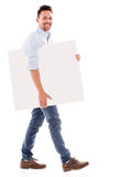 Man carrying a placard Stock Photography