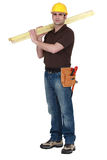 Man carrying planks Royalty Free Stock Images