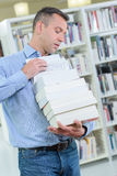 Man carrying precarious stack books Royalty Free Stock Photography